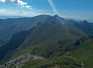Поглед назад от подсичането на връх Жълтец. Виждат се Кръстците и между Купена и  Амбарица се подава любимецът ми - Вежен