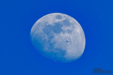 Plane on the background of the moon