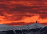 Sunrise lights over Arc of Freedom at Beklemeto