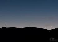 Връх Ботев и сърпа на новата Луна пресичан от самолет
