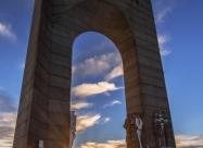 Sunset rays through Arch of Freedom